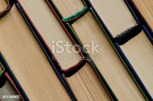 istock Many old books, top view, like background 924185802