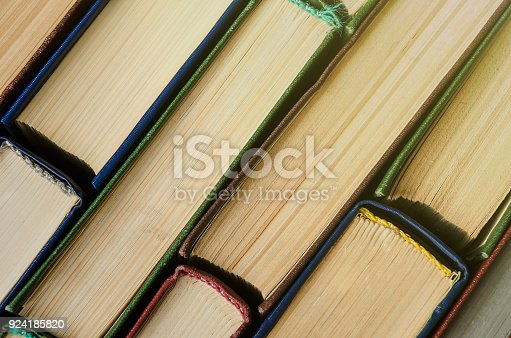 istock Many old books, top view, like background 924185820