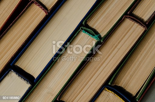 istock Many old books, top view, like background 924185880
