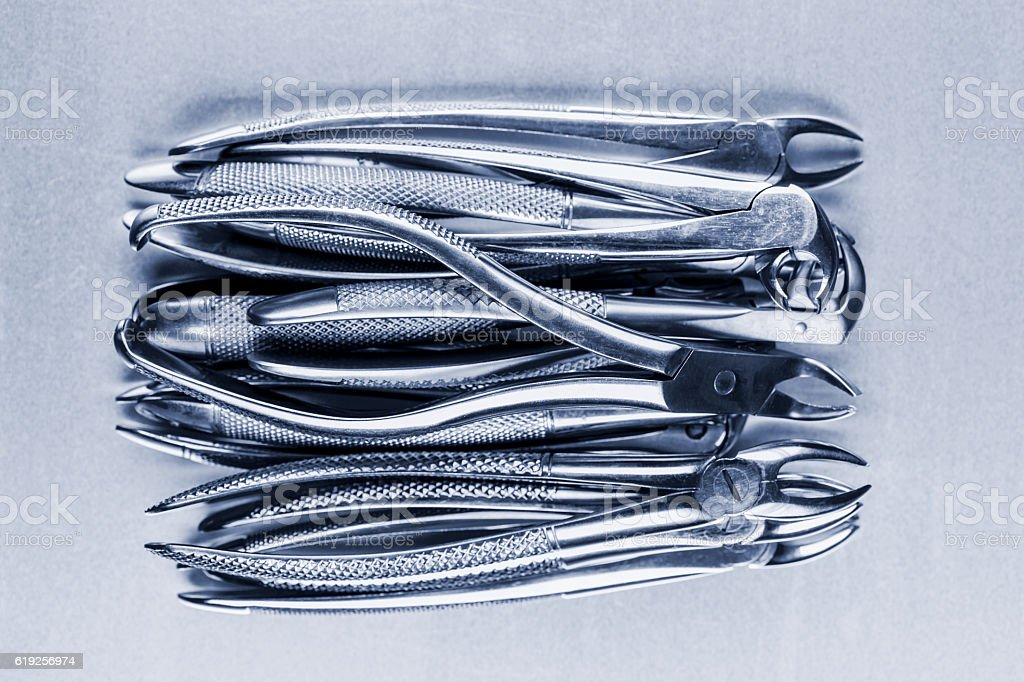 many old dental pincers - removers stock photo