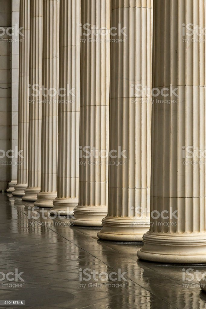 Many old greek columns with reflection stock photo
