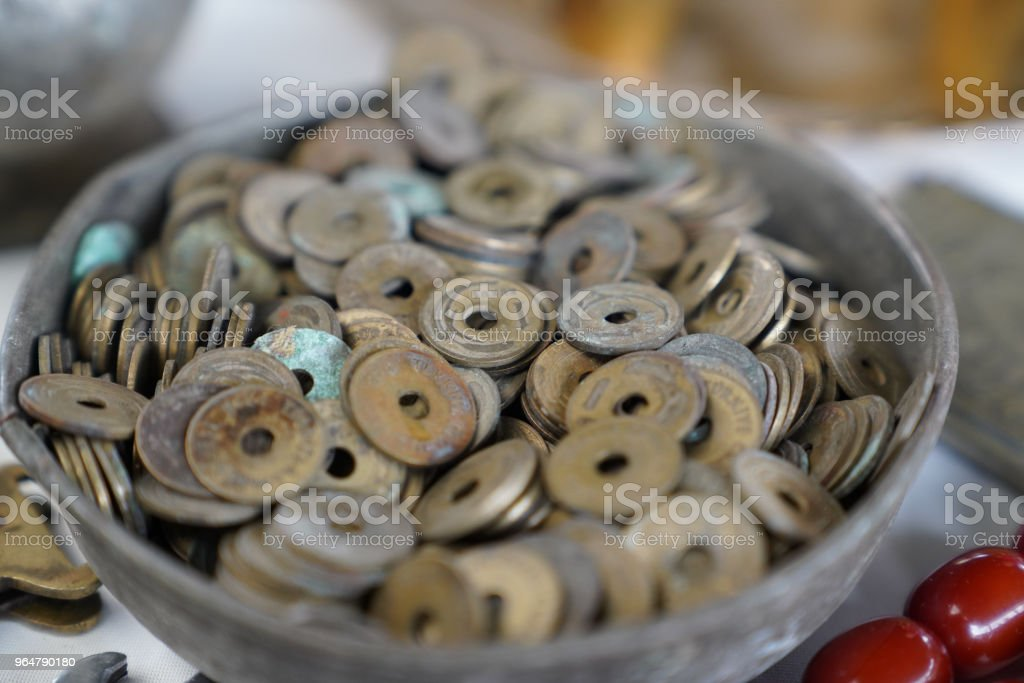 Many old pennies (called delikli kurus in Turkish) in a bowl royalty-free stock photo
