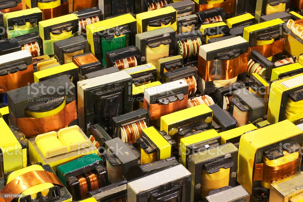 Many old used electrical ferrite power transformers stock photo