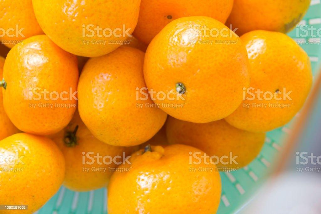 many orange in light green basket stock photo