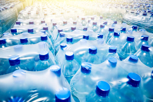 Many packaged blue mineral water bottles stock photo