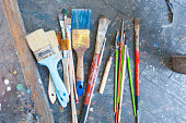 many paint brushes on the floor