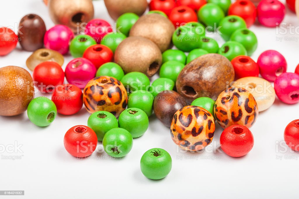 many painted wooden round beads stock photo