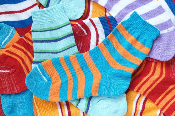 Many pairs of child's striped socks stock photo