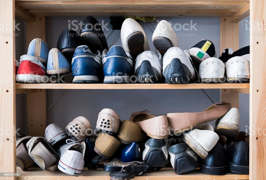 Many pairs of shoes stock photo