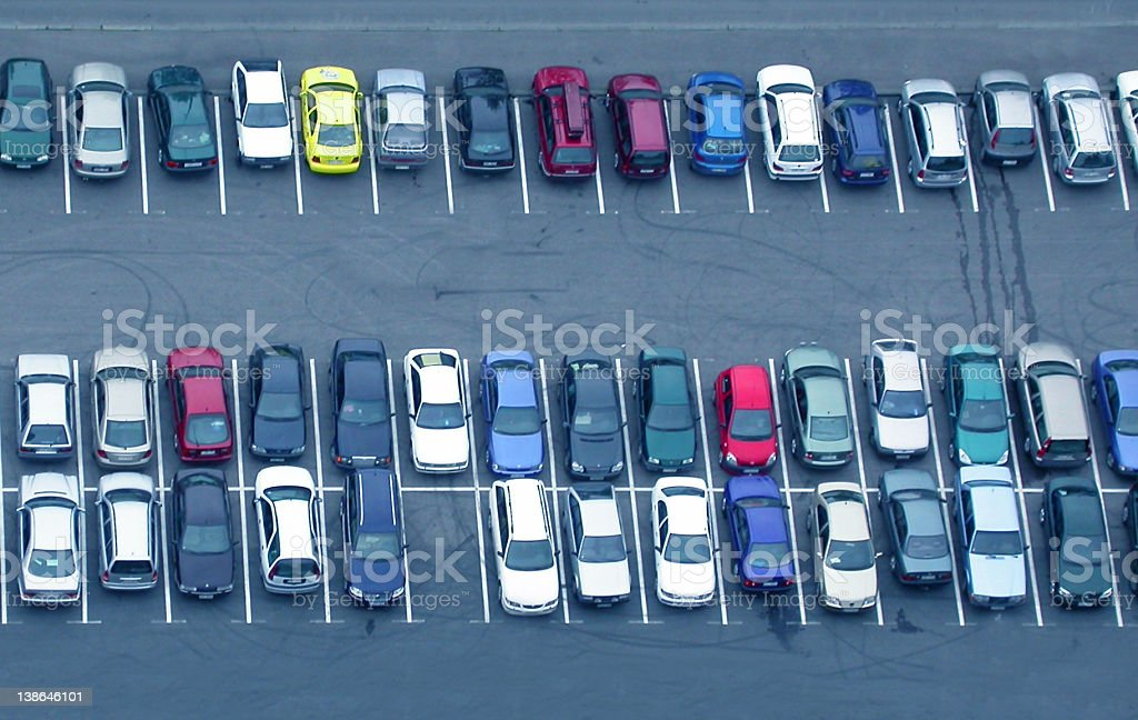 Many parked cars and a large parking lot stock photo