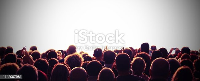 many people and the customizable white background during an event with vintage toned effect
