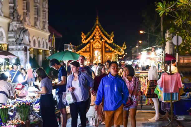 many people are shopping along the road of Tha pae walking street at Chiangmai stock photo
