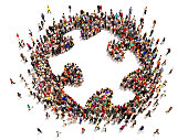 istock Many people forming a giant puzzle piece 473609000