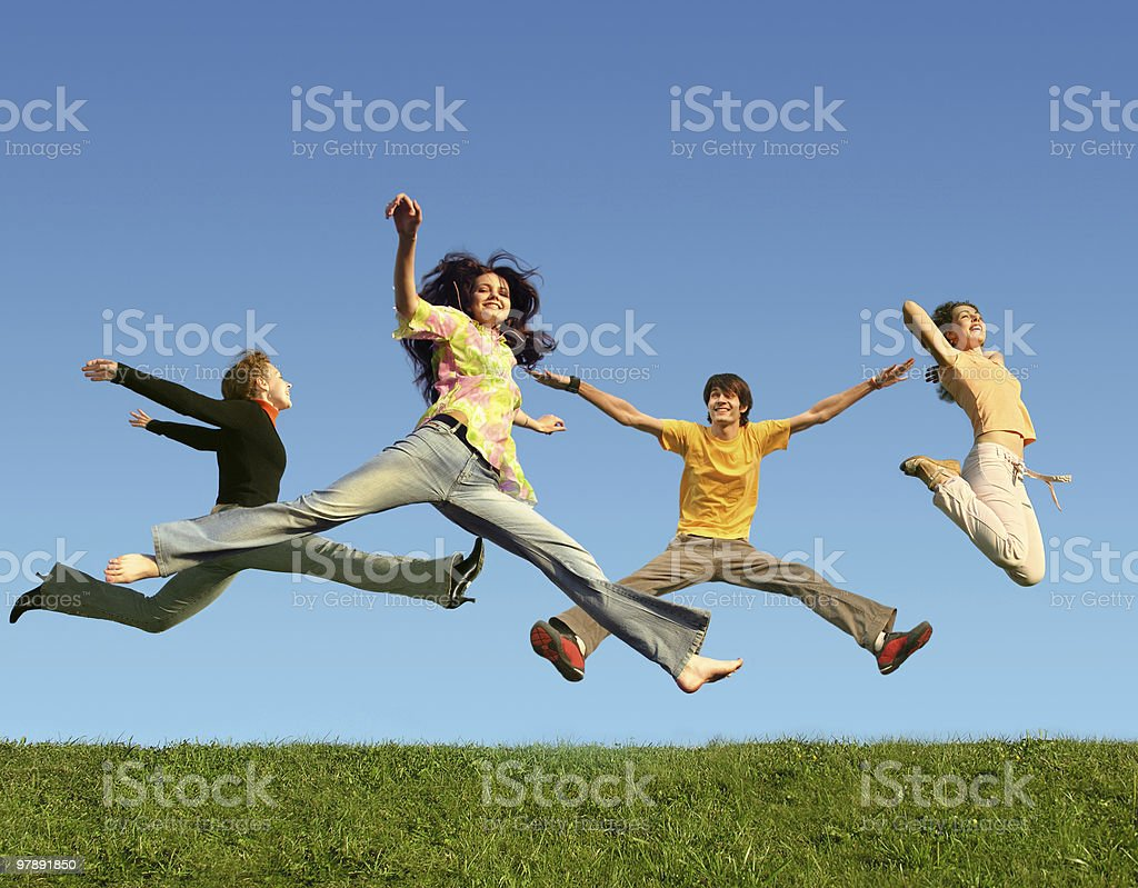 Many people jumping on the grass, collage royalty-free stock photo