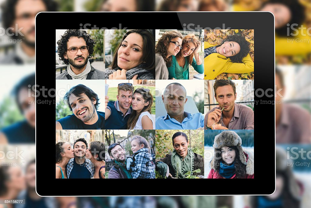 Many people portrait on a tablet screen stock photo