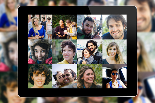 Many people portrait on a tablet screen.