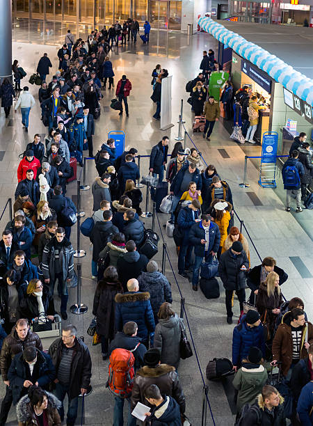Many people standing in a queue to register at Vnukovo stock photo