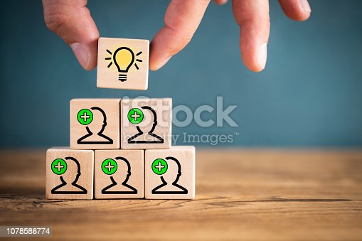 istock many people together having an idea symbolized by icons on cubes 1078586774