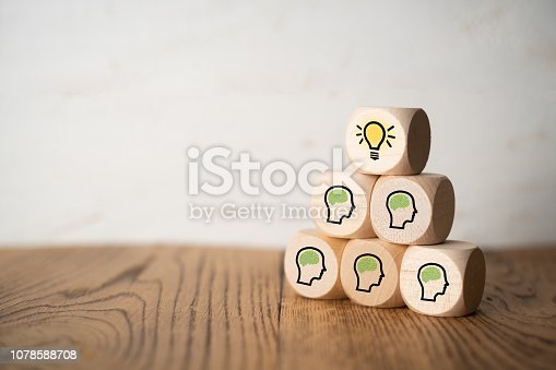 istock many people together having an idea symbolized by icons on cubes 1078588708
