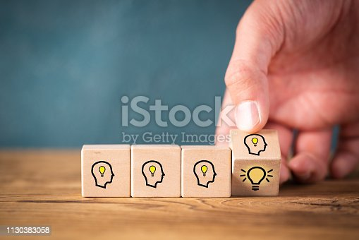istock many people together having an idea symbolized by icons on cubes 1130383058