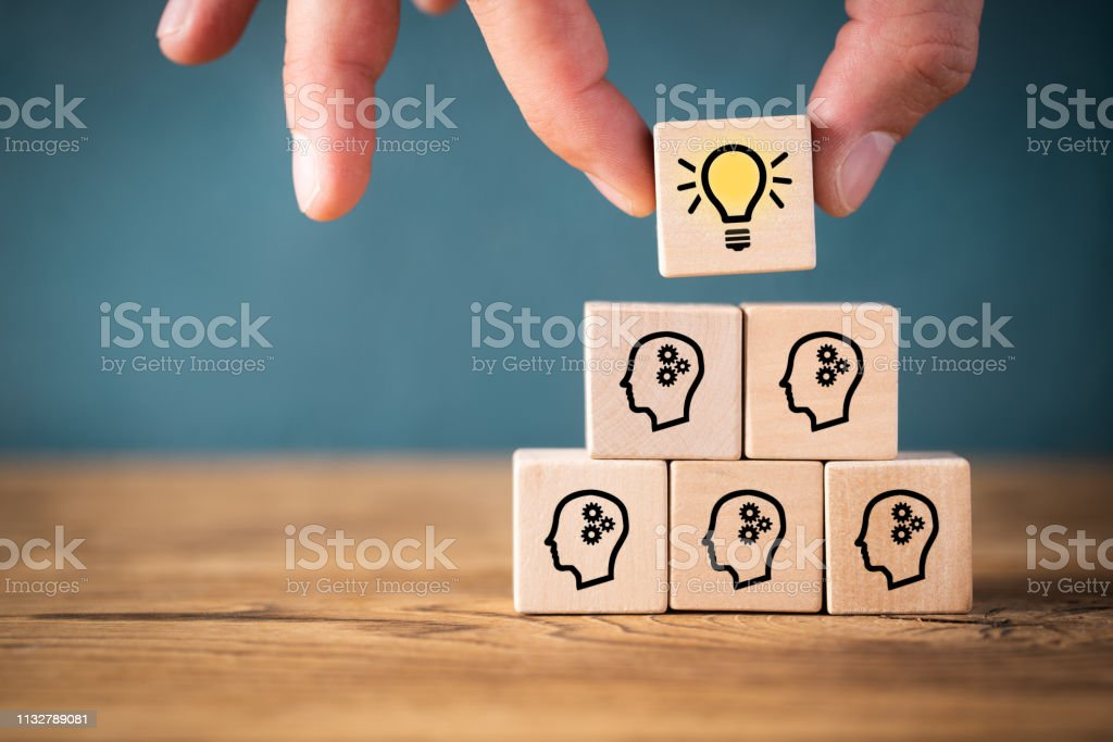 many people together having an idea symbolized by icons on cubes - Стоковые фото Employee роялти-фри