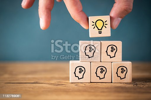 istock many people together having an idea symbolized by icons on cubes 1132789081
