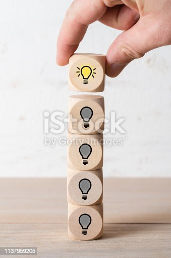 istock many people together having an idea symbolized by icons on cubes 1137959205