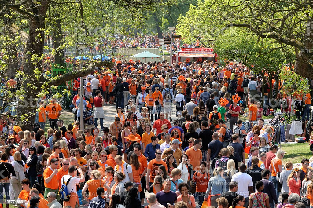 Many people walking in the Vondelpark on Queen's day stock photo