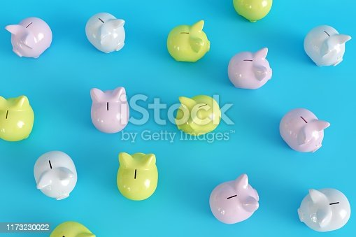 istock Many Piggy Bank on blue background. top view. minimal concept ideas.
