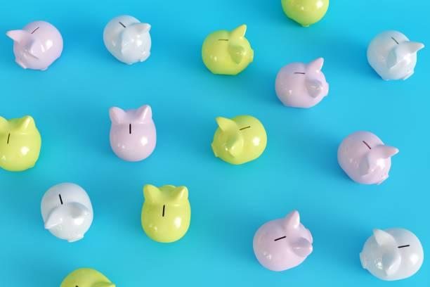 Viele Piggy Bank auf blauem Hintergrund. Ansicht von oben. minimalen Konzeptideen.