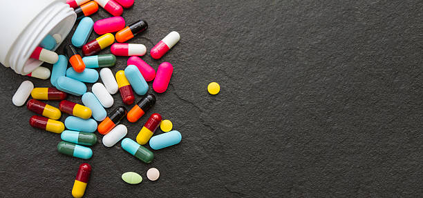 Many pills and tablets on black background. stock photo