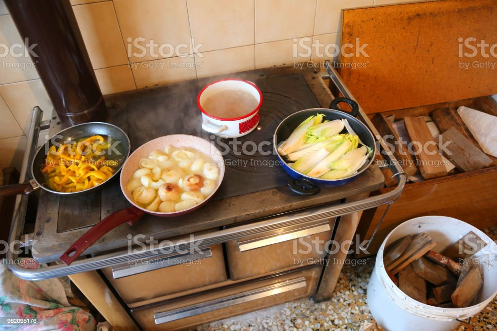 many pots with vegetables over an economical cooker stock photo