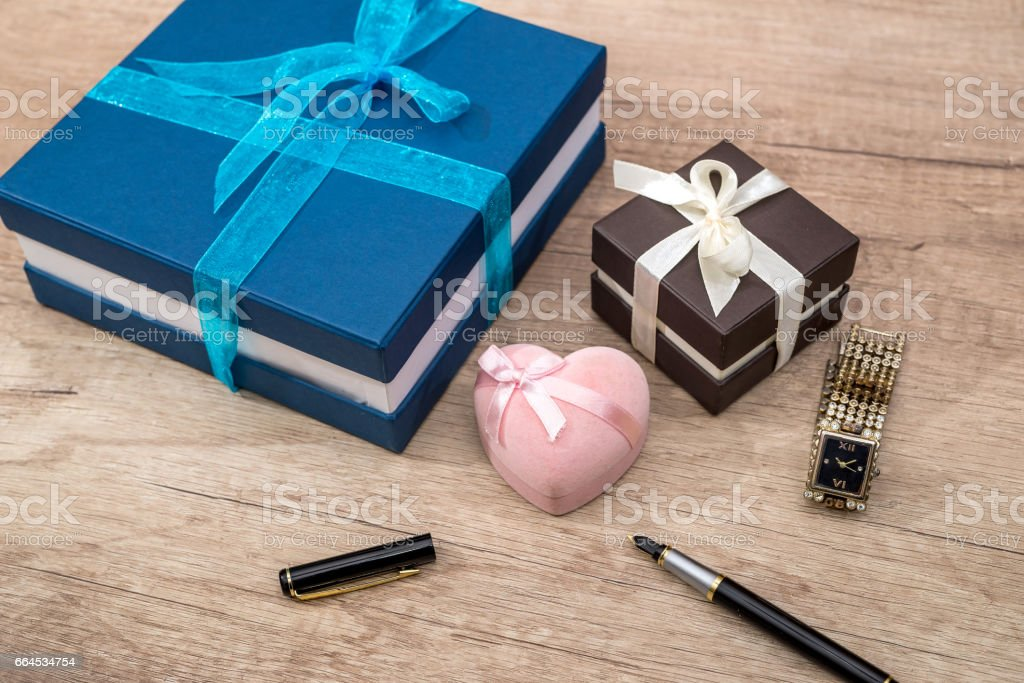 many present box with clock on desk. royalty-free stock photo