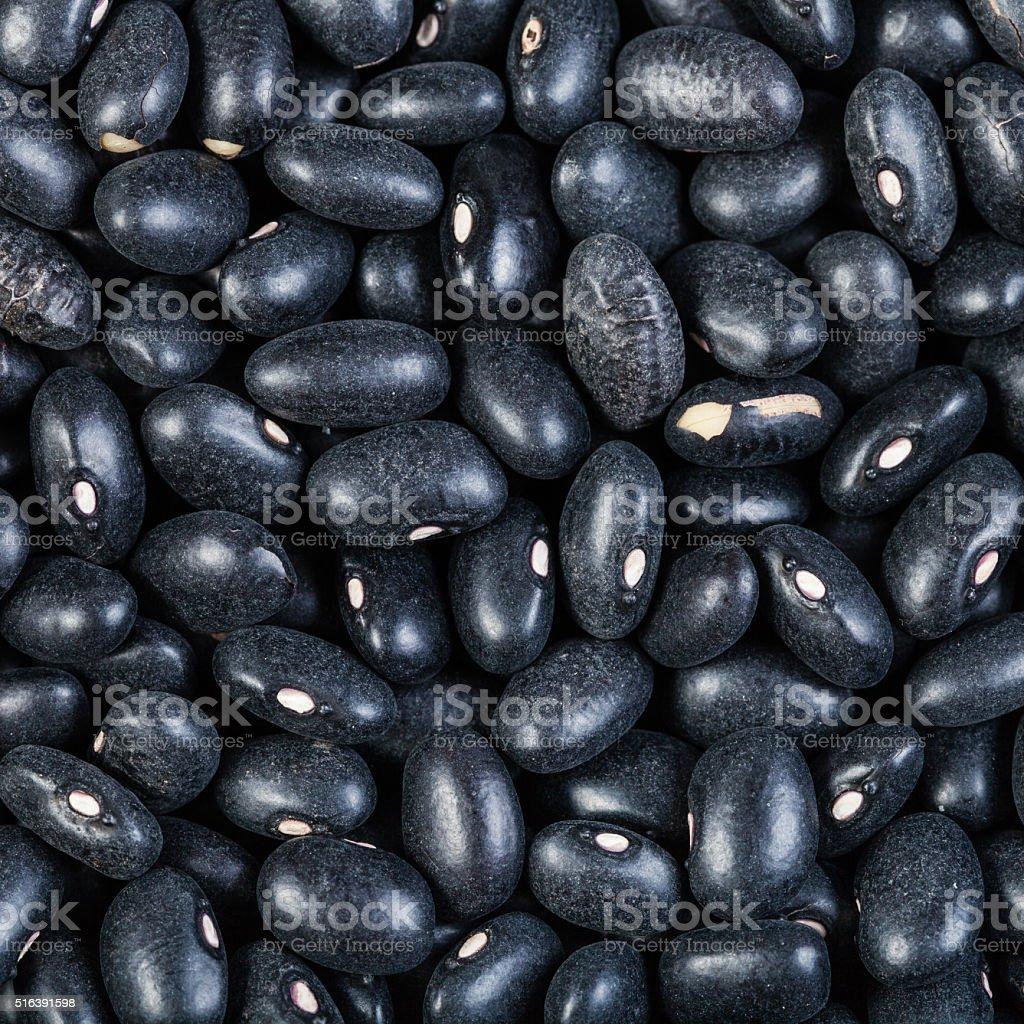 many raw Black turtle beans close up stock photo