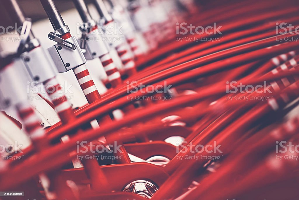 Many red bicycles stock photo