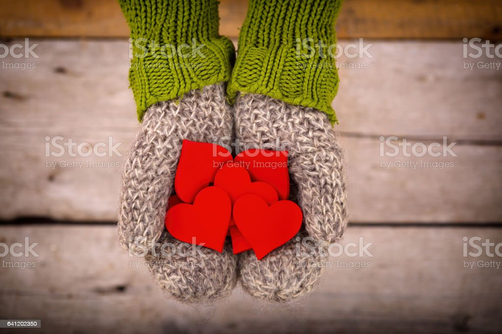many red hearts in hands stock photo