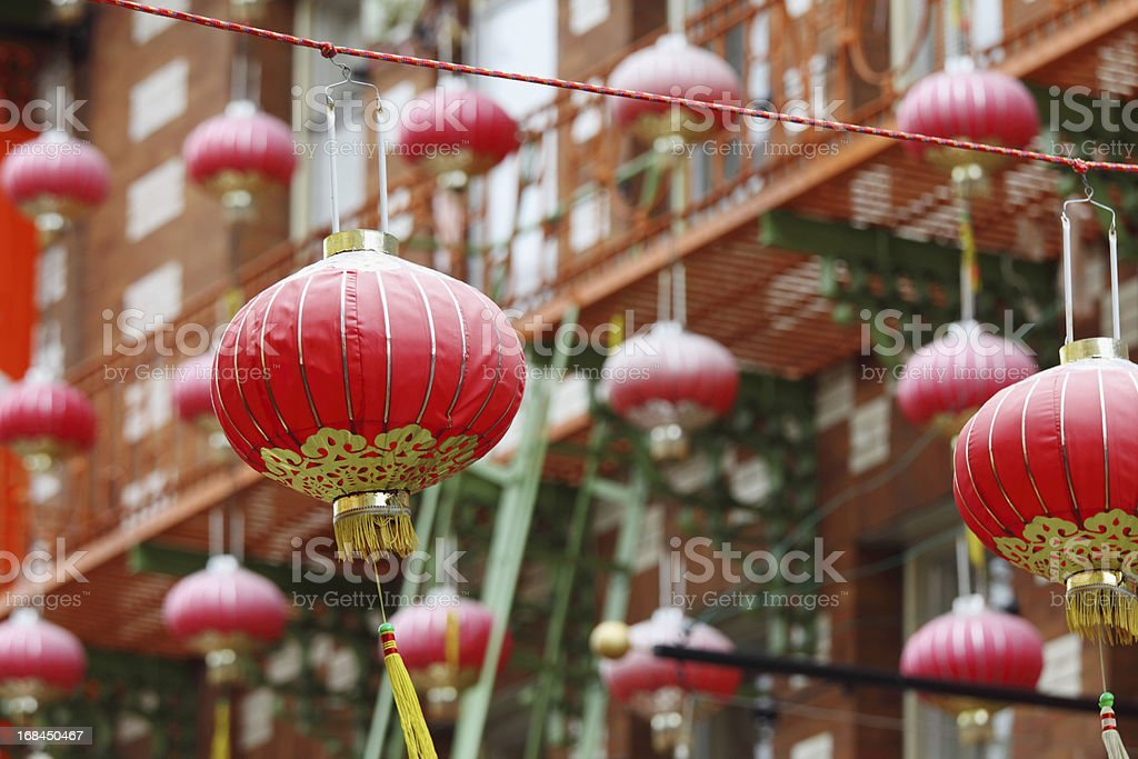 many red lantern against building stock photo