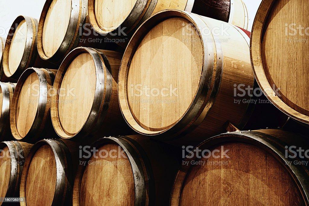 stacked oak barrels. Many Rows Of Stacked Oak Wine Barrels In Winery Cellar Royalty-free Stock Photo O