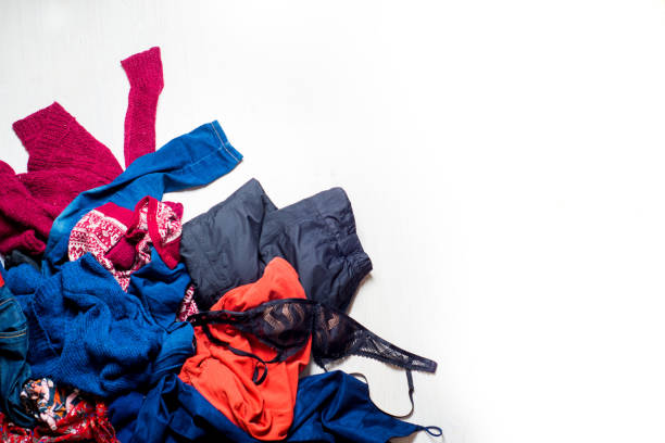 many scattered clothes on a white background. Place for text.Copyspace stock photo