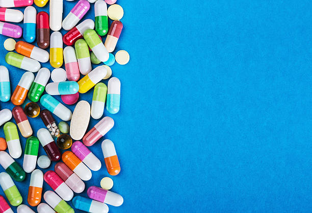 many scattered Colorful pills – Foto
