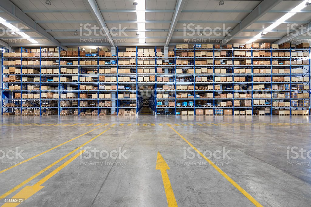 Many shelves of cardboard boxes in storehouse stock photo