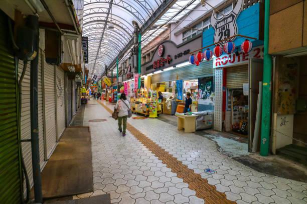 Many shops at Kokusai Dori Street Okinawa Japan OKINAWA, JAPAN - MARCH 1, 2017 : Shops and market in Kokusai Dori Street in Naha Okinawa Japan kokusai dori okinawa stock pictures, royalty-free photos & images