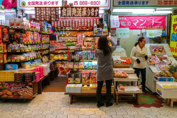 Many shops at Kokusai Street Okinawa Japan OKINAWA, JAPAN - MARCH 1, 2017 : Shops and market in Kokusai Dori Street in Naha Okinawa Japan kokusai dori okinawa stock pictures, royalty-free photos & images