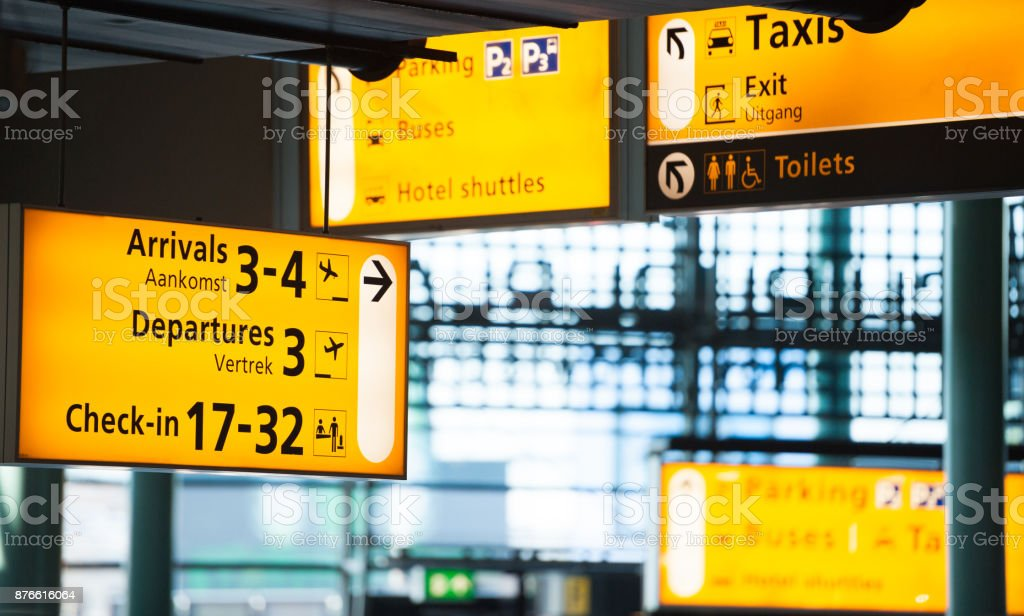 Many signs in airport terminal building - foto stock