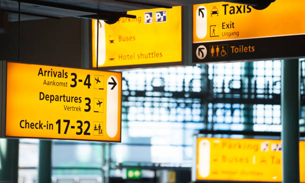 Many signs in airport terminal building stock photo