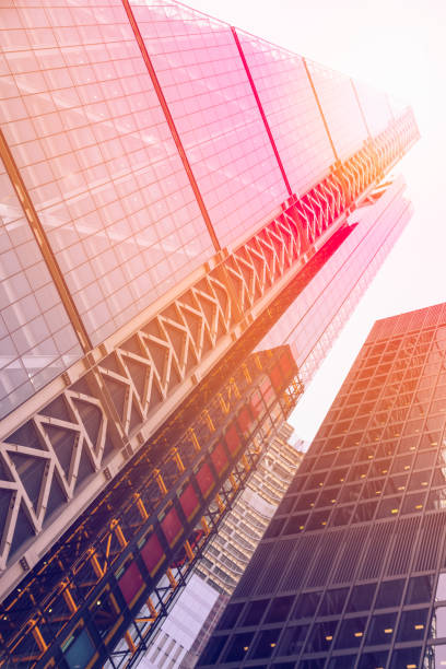 Many skyscrapers with sunlight in London financial district stock photo