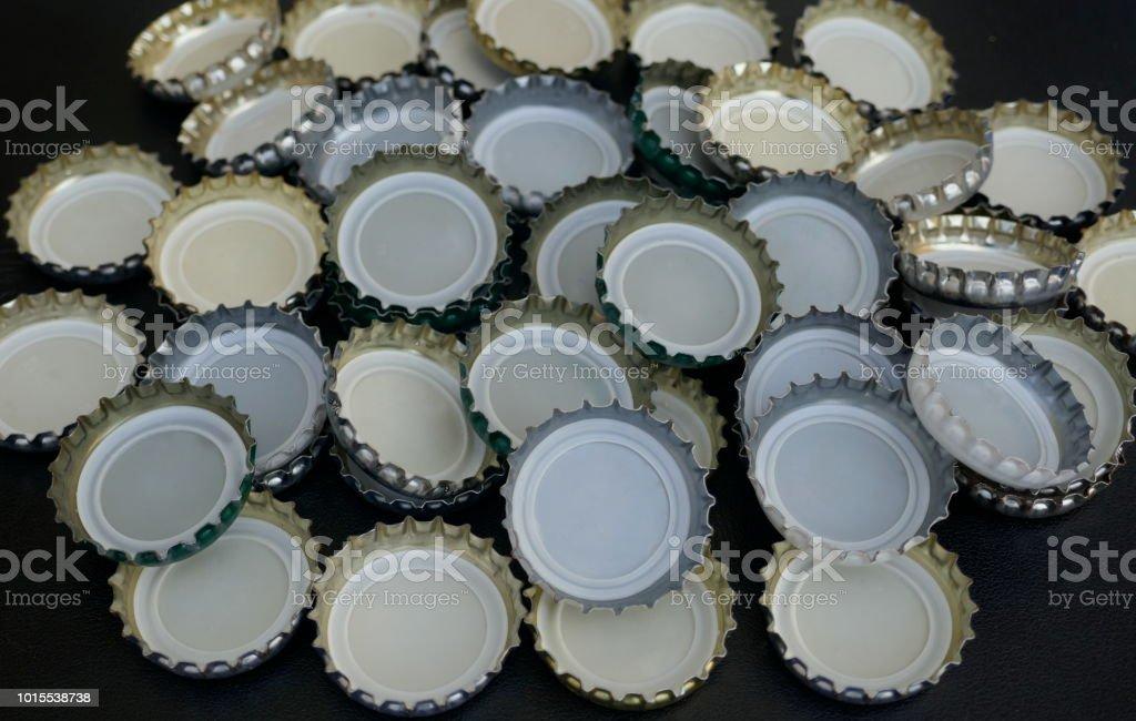 Many small metal bottle stopper, beer bottle caps, metal bottle caps,...