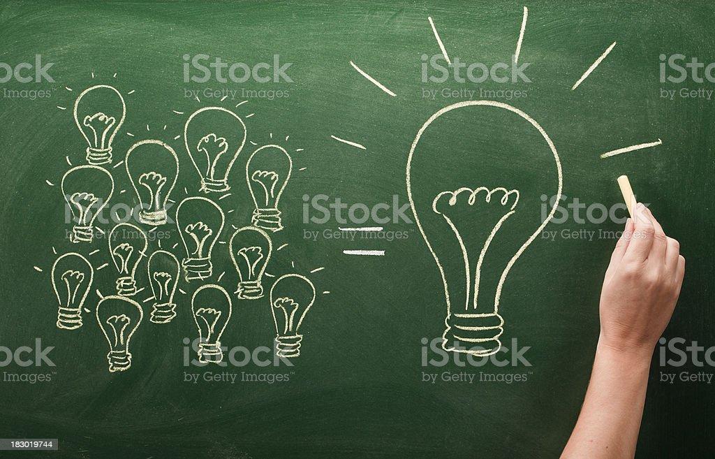many small light bulbs equal big one stock photo