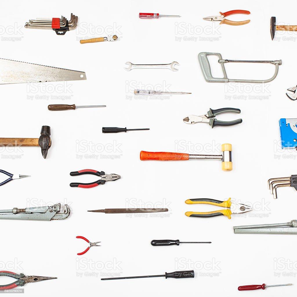 many small tools arranged on white stock photo