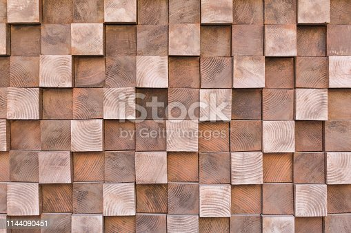 istock Many small wooden cubes of different heights, tightly lying one after another, imitating the texture of the wall 1144090451